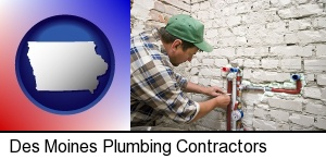 a plumbing contractor installing new water supply lines in Des Moines, IA