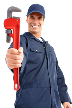 a plumber holding a red pipe wrench