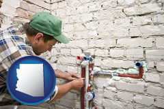 az map icon and a plumbing contractor installing new water supply lines