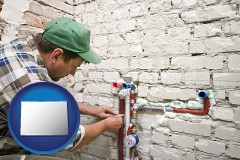 co map icon and a plumbing contractor installing new water supply lines