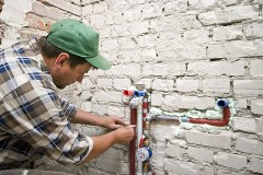 a plumbing contractor installing new water supply lines