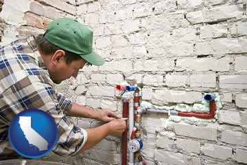 a plumbing contractor installing new water supply lines - with California icon