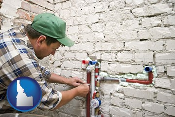 a plumbing contractor installing new water supply lines - with Idaho icon