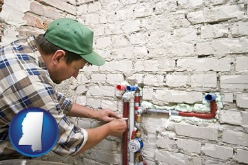 a plumbing contractor installing new water supply lines - with Mississippi icon
