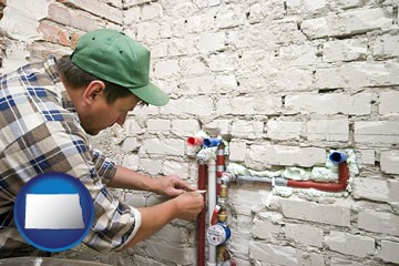 a plumbing contractor installing new water supply lines - with North Dakota icon