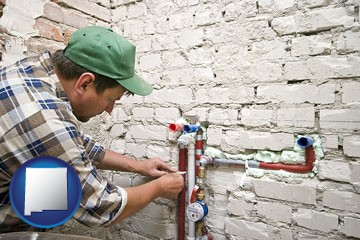a plumbing contractor installing new water supply lines - with New Mexico icon