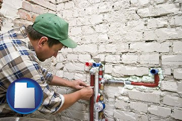 a plumbing contractor installing new water supply lines - with Utah icon